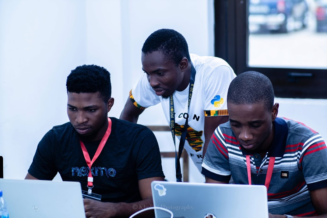 A Group Of Developers During A Sprints Session At Pycon Africa
